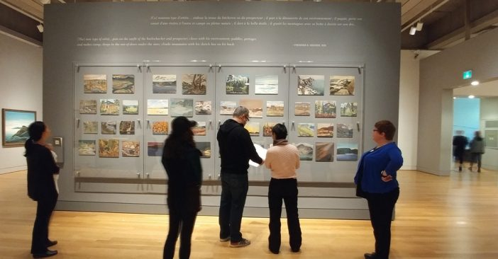 Peers looking at wall of art